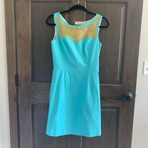 Blue and gold fit and flare dress